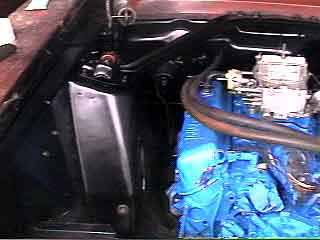 The engine compartment sports a new battery tray!